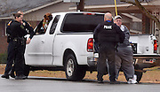Photo by Gary Cosby Jr.     Hartselle Police take two suspects into custody on Vaughn Bridge Rd. near the old National Guard Armory Friday, January 23, 2013.  The men were suspects in a bank robbery in Decatur.