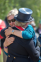 Zara Phillips (GBR)  is embraced by Team GBR dressage coach Tracie Robinson<br /> CCI 4* Luhmuhlen 2013<br /> © Hippo Foto - Jon Stroud