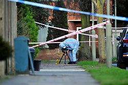 """© Licensed to London News Pictures.10/01/2018<br /> Chislehurst, UK.<br /> CHISLEHURST MURDER. Police Forensic Officer on scene at 4.15PM. An """" A""""  marks the spot the 18 year old was found.<br /> Police Inner Cordon around the scene.<br /> A murder investigation has been launched in Chislehurst after an 18-year-old man was assaulted and died from his injuries. Police were called at approximately 21:05hrs on Tuesday, 9 January to reports of a fight on Empress Drive in Chislehurst.Officers attended and found an injured man. He was taken by the London Ambulance Service to a south a London hospital where he later died shortly after 08:00hrs.His next of kin have been informed. <br /> <br /> Photo credit: Grant Falvey/LNP"""