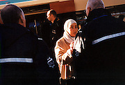 Controllers check the ticket of a Muslim woman at the Lelylaan station in west Amsterdam. .Picture taken 2005 by Justin Jin