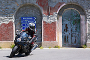 Motorcyclist on Suzuki R GSX motorbike drives The Stelvio Pass, Passo dello Stelvio, Stilfser Joch, to Bormio, Northern Italy