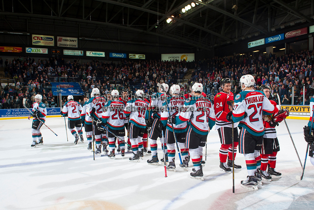 KELOWNA, CANADA - APRIL 14: The Kelowna Rockets shake hands with the Portland Winterhawks after winning game 5 and the second round of playoffs on April 14, 2017 at Prospera Place in Kelowna, British Columbia, Canada.  (Photo by Marissa Baecker/Shoot the Breeze)  *** Local Caption ***