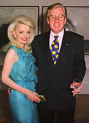MR & MRS GORDON McNALLY he is the brother of Paddy McNally the multi-millionaire motor racing businessman, at a reception in London on 6th August 1998.MJJ 5