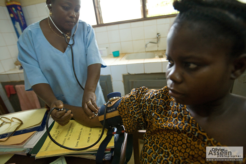 A health worker checks the blood pressure of a pregnant woman at the Abomey health center in the town of Abomey, Benin on Monday September 17, 2007.