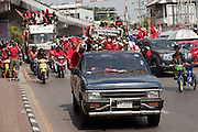 Apr. 12, 2010 - BANGKOK, THAILAND: Trucks carrying the bodies of Thais killed in the fighting Saturday night are driven through the streets of Bangkok Monday. The funeral cortege for the Red Shirts killed in the violent crackdown Saturday wound through Bangkok Monday. 21 people, including 16 Thai civilians were killed when soldiers tried to clear the Red Shirts' encampment in Bangkok. Thousands of mourners came out to pay respects for dead Red Shirts. Thousands more came out to call for the government of Thai Prime Minister Abhisit Vejjajiva to step down. Today Gen. Anupong Paojinda, the Chief of Staff of the Thai Army, reiterated that the Army would not use violence to break up the protests and joined the call for the Prime Minister to call new elections. This is the beginning of Songkran, Thai New Year's week, and the government has cancelled the official festivities fearing more violence. It was during last year's Songkan festivities that the Thai Army and police used force to break up the Red Shirt protests. That protest is now called the Songkran Riots.     Photo By Jack Kurtz