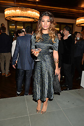 Singer VANESSA WHITE at a party to celebrate the 15th anniversary of Myla held at the House of Myla, 8-9 Stratton Street, London on 21st October 2014.