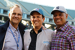 OAKLAND, CA - JUNE 14:  Major League Baseball executive and former manager Joe Torre, philanthropist Michael Milken, and Baseball Hall of Fame inductee Reggie Jackson stand on the field for the Prostate Cancer Foundation to raise awareness and funding for prostate cancer before the game between the Oakland Athletics and the New York Yankees at O.co Coliseum on June 14, 2014 in Oakland, California. The Oakland Athletics defeated the New York Yankees 5-1.  (Photo by Jason O. Watson/Getty Images) *** Local Caption *** Joe Torre; Michael Milken; Reggie Jackson