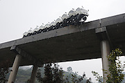 KAILI, CHINA - OCTOBER 21:  China Out - Finland Out<br /> <br /> Trailer Hangs On The Edge Of Bridge<br /> <br /> A trailer loaded with trucks hangs on the edge of a bridge on October 21, 2013 in Kaili, Guizhou Province of China. The driver lost control of the vehicle, and no casualties were reported.<br /> ©Exclusivepix