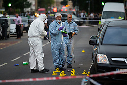 © Licensed to London News Pictures. 10/07/2015. London, UK. Police and forensics forensics at the scene of a double shooting on Lordship Lame in Wood Green, north London in which a man has died and a woman is currently being treated in hospital.  Photo credit: Ben Cawthra/LNP