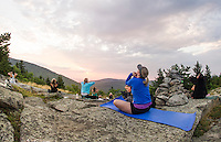 Kelli Powers practices yoga during a sunrise yoga class on the top of Piper Mountain with Kate Criscone from Body Design by Joy on Saturday morning.  (Karen Bobotas/for the Laconia Daily Sun)
