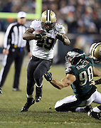 New Orleans Saints running back Khiry Robinson (29) high steps and eludes the outstretched arm of Philadelphia Eagles outside linebacker Connor Barwin (98) as he runs to the Eagles 15 yard line in the fourth quarter during the NFL NFC Wild Card football game against the Philadelphia Eagles on Saturday, Jan. 4, 2014 in Philadelphia. The Saints won the game 26-24. ©Paul Anthony Spinelli