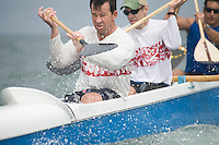 Outrigger canoeing team raise oars