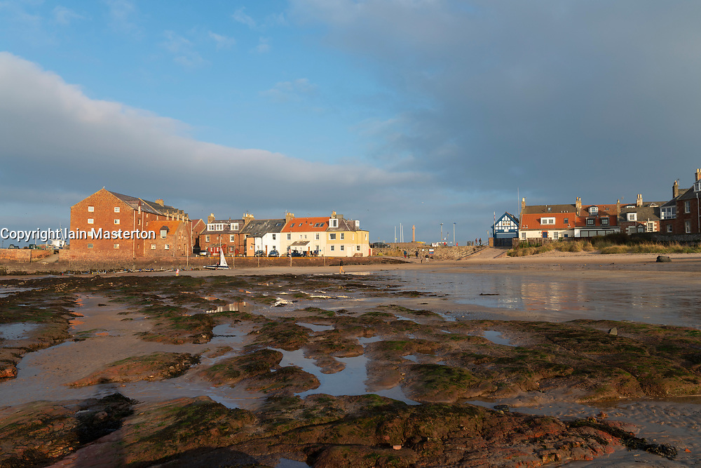 View of North Berwick harbour buildings from West Bay beach at low tide on autumn afternoon, East Lothian,Scotland ,UK.