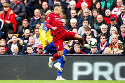 Roberto Firmino of Liverpool beats Jannik Vestergaard of Southampton to the ball - Mandatory by-line: Robbie Stephenson/JMP - 22/09/2018 - FOOTBALL - Anfield - Liverpool, England - Liverpool v Southampton - Premier League
