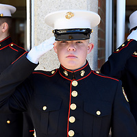 Riley Dinger (center), Jake Pieschke (left) and Chynna Labata, with the Lincoln High School marine corp, stand at attention at the front doors of Lincoln High School welcoming attendees of the Sioux Falls Area Chamber of Commerce Veterans Day program on Friday, Nov. 11, 2016.