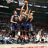 25 March 2016: Utah Jazz center Rudy Gobert (27) grabs a rebound between Utah Jazz forward Gordon Hayward (20) and Utah Jazz guard George Hill (3) during the Los Angeles Clippers 108-95 victory over the Utah Jazz, at the Staples Center, Los Angeles, California, USA.