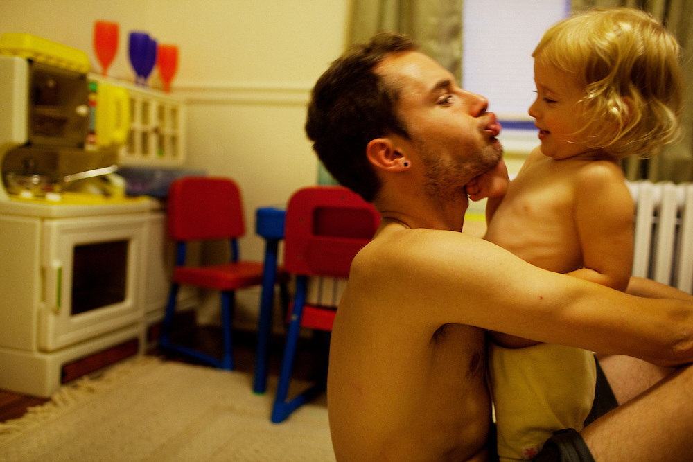 Matt Eich, 23, and his daughter Madelyn, 2, goof off while spending time together in Norfolk, Virginia on Sunday,  June 7, 2010.