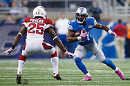 Detroit Lions running back Ameer Abdullah (21) rushes on Arizona Cardinals cornerback Jerraud Powers (25) during an NFL football game at Ford Field in Detroit, Sunday, Oct. 11, 2015. (AP Photo/Rick Osentoski)