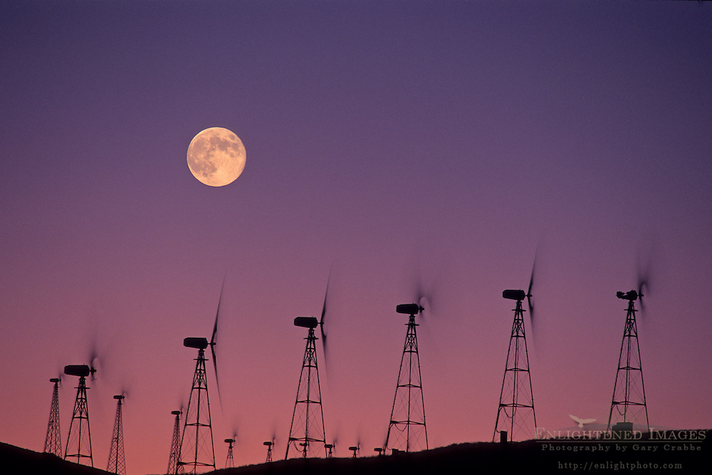 Moon over wind turbine clean energy windmills, Altamont Pass, Alameda County, California
