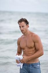 good looking shirtless man in the ocean