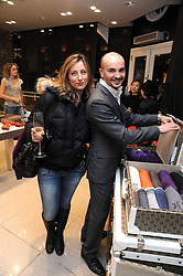 SARA MENO and MR DIONIGI MARTELLI at the MCM Christmas party held at their store at 5 Sloane Street, London on 26th November 2008.