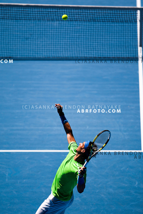 18 January 2012 : Rafael Nadal (ESP) serves in his 2nd round match against Tommy Haas (GER)  during Day 3 round 2 of the Australian Tennis open grand slam event at Melbourne Park, Melbourne Australia.