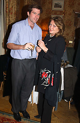 LORD JAMES CECIL and LEONORA, COUNTESS OF LICHFIELD at a private view of jewellery designed and made by Luis Miguel Howard held at 30 Pavillion Road, London on 27th October 2004.<br />