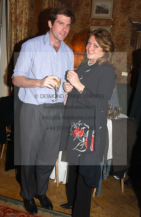 LORD JAMES CECIL and LEONORA, COUNTESS OF LICHFIELD at a private view of jewellery designed and made by Luis Miguel Howard held at 30 Pavillion Road, London on 27th October 2004.<br /><br />NON EXCLUSIVE - WORLD RIGHTS