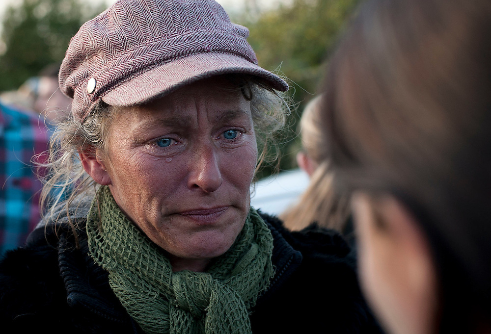 Travellers and protesters show there emotions as the protesters leave and the travellers start to go day 2 at Dale Farm near Basildon, east of London, on October 20, 2011. Riot police have gained control of Britain's biggest illegal travellers' site after meeting violent resistance and a barrage of missiles on entering the camp. Seasoned activists, who have joined the residents, hurled bricks at officers, swung spades at them and torched a caravan on Wednesday at the c