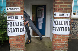 © Licensed to London News Pictures. 23/06/2016. Biggin Hill, UK. UKIP party leader Nigel Farage leans through a small window at the entrance to the polling station as he votes in the EU referendum. Polls have opened for voting - with counting starting after polls close at 10PM.Photo credit: Peter Macdiarmid/LNP
