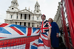 © Licensed to London News Pictures. 16/04/2013. London, UK. Mourners of Margaret Thatcher take their place outside St Paul's Cathedral the day before the funeral ready to sleep overnight and pay their respects.   John Loughrey (left) of Wandsworth London, tells how Margaret Thatchers policies helped Mr Loughrey's father buy his council house in the 80's thus helping him on the housing ladder. Photo credit : Richard Isaac/LNP