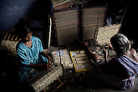 12-10-2007 Kalugumalai Tamil Nadu, India. Children work at home makin matches and matchboxes. The girls are put at work in their own homes so the factory owners cannot be blamed for employing child labour. Terres des Hommes Netherlands tries to convince parents to send their girls to school. If they are forced to work anyway TdH provides eveningclasses for the girls.