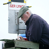 A bookie checks the odds at the annual Lisdoonvarna Races at the weekend.<br />