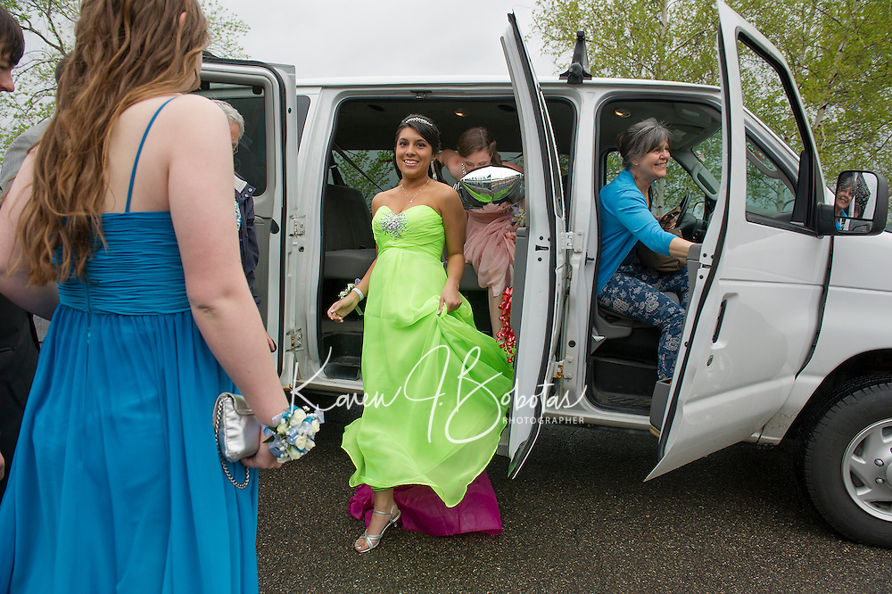 Bonita Olivares and Emily Paronta arrive in style for Laconia High School's Junior Prom at the Opechee Conference Center Friday evening.  (Karen Bobotas/for the Laconia Daily Sun)
