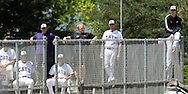 The Kansas State bullpen watches the action against Baylor perched high on the bullpen fence.  K-State defeated the Baylor Bears 3-1 at Tointon Stadium in Manhattan, Kansas, May 20, 2006.