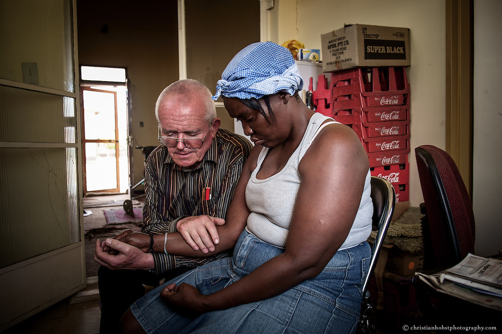 (2013)  Father Hermann counsels a woman who seeks his help at his home at the church in Pioneers Park.