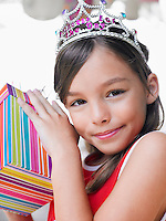 Portrait of young girl (7-9) with birthday present close-up
