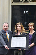 © Licensed to London News Pictures. 11/06/2013. Westminster, UK LEFT TO RIGHT Adrian Sanders MP, Penny Mordaunt MP and Caroline Lucas MP.  An open letter to Lord Taylor of Holbeach is handed into Downing Street today 11th June 2013 The letter from the British Union for the Abolition of Vivisection (BUAV) calls on the Government to set up an independent inquiry into animal suffering. Photo credit : Stephen Simpson/LNP
