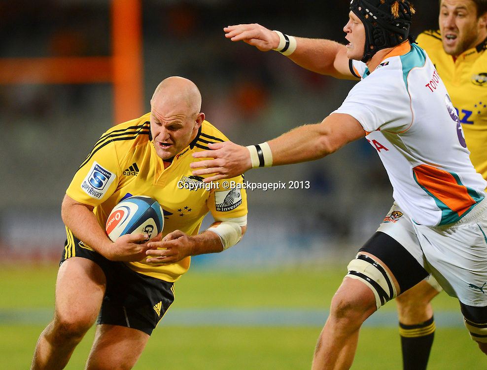 Ben Franks of the Hurricanes tackled by Phillip van der Walt of the Cheetahs during the Super Rugby match between the Cheetahs and the Hurricanes at the Free State Stadium in Bloemfontein on May 10, 2013©Barry Aldworth/BackpagePix