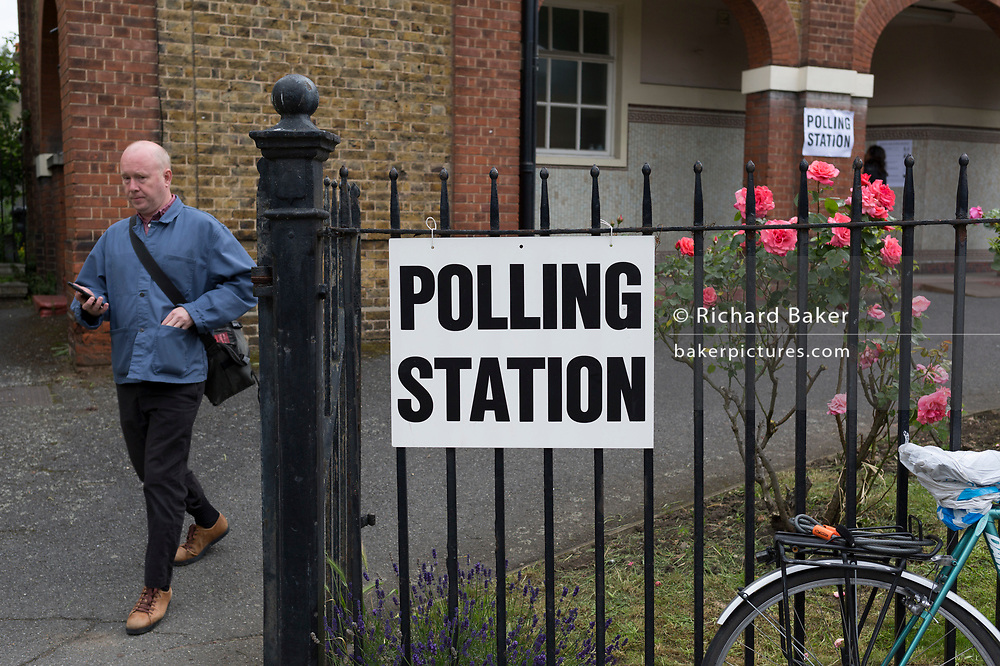 A voter leaves the polling station on the morning of the UK 2017 general elections outside the polling station at St. Saviour's Parish Hall in Herne Hill, Lambeth, on 8th June 2017, in London, England.
