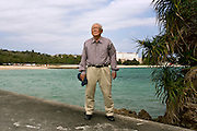 Mr Nagamasa HIRAYOSHI, 74, a retired civil servant from Naha and a life time anti-base activist and promoter of the Ryukyu culture. In the background Camp Schwab in Henoko.<br /> <br /> Mr Hirayoshi comes once a week from Naha, a three hours round trip by car, to join the protests against the extension of Camp Schwab. His greatest resentment is against the Japan Government that has &quot;always been treating Okinawa people like second-class citizen&quot; he explains.<br /> <br /> He saw when he was a child his city of Naha destroyed by the bombings of the war and remember the violences of the U.S. military against the Okinawan people. <br /> <br /> Okinawa governor Mr Onaga, elected in 2014, and the large majority of Okinawa people have long objected to the relocation of Futenma Air Station, a contentious US Marine Corps base, to the remote fishing village of Henoko on the northern part of the island. Part of the plan involves the construction of military runways on reclaimed land out of coral-filled coastal waters next to the Camp Schwab base.<br /> <br /> A survey last year found that 84 per cent of Okinawans oppose the planned Henoko base &ndash; the highest share since the government of Shinzo Abe took power in 2012. But Henoko is central to Abe&rsquo;s plans to boost Japan military defences across Okinawa&rsquo;s 160-island Ryukyu chain.