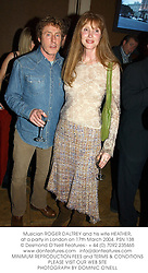 Musician ROGER DALTREY and his wife HEATHER, at a party in London on 17th March 2004.PSN 138