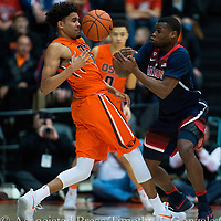 Oregon State's Stephen Thompson Jr., left, has the ball knocked away by Arizona's Kadeem Allen during the first half of an NCAA college basketball game in Corvallis, Ore., Thursday, Feb. 2, 2017.  (AP Photo/Timothy J. Gonzalez)