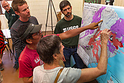 Residents and other interested parties talk about the current threats about the Kīlauea Volcano lower east rift zone eruption with USGS staff during recent community meeting at Pahoa High School on Tuesday, June 5, 2018, in Pahoa, Hawaii.