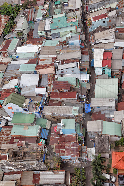 """Aerial view of a neighborhood in Cholon with typical colored rectangular houses also called """"tube houses,"""" some just four meters wide, Ho Chi Minh City, Vietnam, Southeast Asia"""