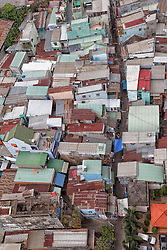 "Aerial view of a neighborhood in Cholon with typical colored rectangular houses also called ""tube houses,"" some just four meters wide, Ho Chi Minh City, Vietnam, Southeast Asia"