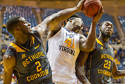 Nov 23, 2015; Morgantown, WV, USA; West Virginia Mountaineers forward Devin Williams grabs a rebound during the first half against the Bethune-Cookman Wildcats at WVU Coliseum. Mandatory Credit: Ben Queen-USA TODAY Sports