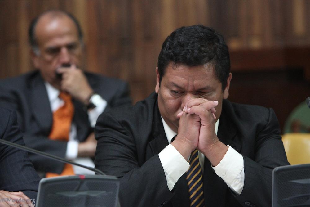 Public Defendant Otto Ramirez listens to defense lawyer Francisco García Gudiel argue for a suspension of the trial. Guatemala City, Guatemala. May 08, 2013.