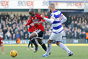 Fulham striker Sone Aluko (24) takes on Queens Park Rangers defender Joel Lynch (6) during the EFL Sky Bet Championship match between Queens Park Rangers and Fulham at the Loftus Road Stadium, London, England on 21 January 2017. Photo by Andy Walter.
