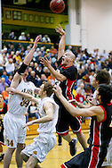 1/13/2006: Marcus Clift of the Northwest Nazarene University Crusaders takes a shot in the Alaska Anchorage comeback victory over Northwest Nazarene, 60-57, in men?s basketball action at the Wells Fargo Sports Complex on Saturday.